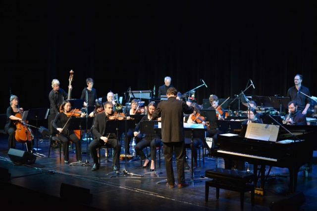 Daniel conducting the orchestra