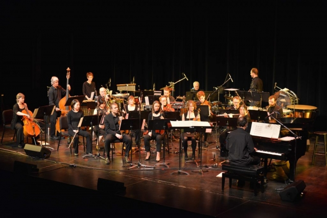 A large picture of the orchestra playing